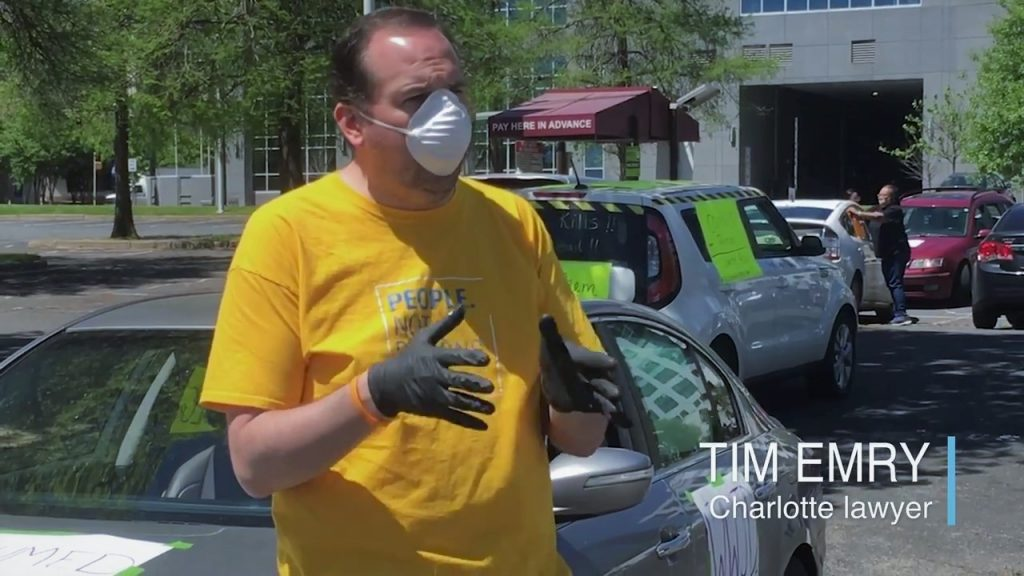 Tim Emry | Charlotte Lawyer in a mask